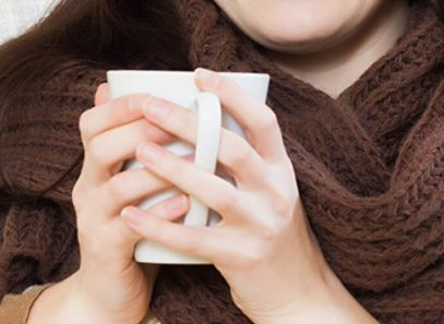 woman with warm coffee cup