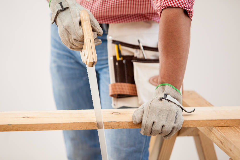 Man using handsaw