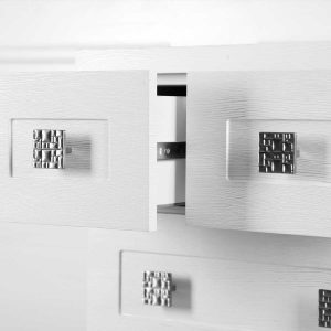 white drawer with metal knobs