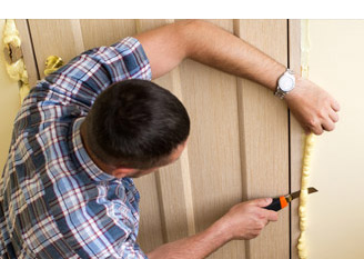 man cutting insulation