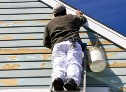 man working on siding