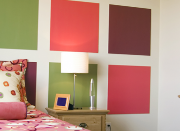 bedroom with large squares painted on wall