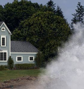wave crashing towards house