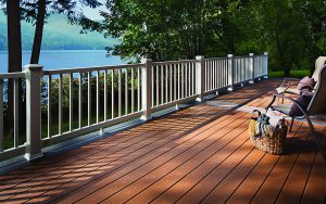 Deck with a fence overlooking a lake