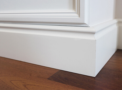Image of molding placed on top of laminate flooring