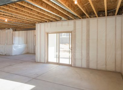 Image of a ground floor basement with insulation showing