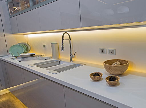 Flexible lighting LED strip underneath kitchen cabinets